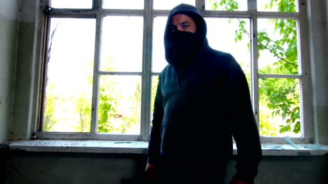 man with mask and hoodie in front of the window - gang stock videos & royalty-free footage