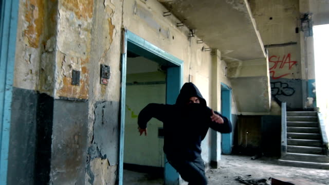 man with mask and hoodie running toward the camera - aggression stock videos & royalty-free footage