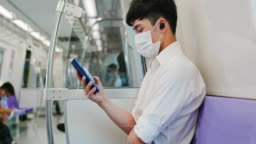 man with mask in mrt