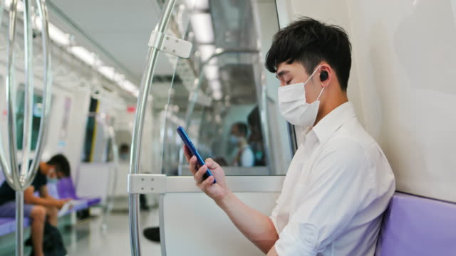 man with mask in mrt - bluetooth stock videos & royalty-free footage