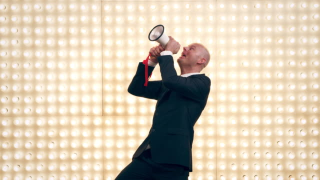 man with megaphone in front of lightwall - public speaker stock videos & royalty-free footage