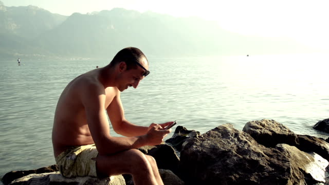 Man with mobile phone on the beach