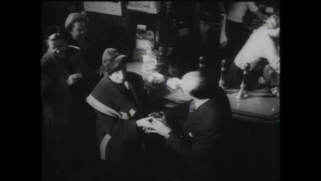 man with moustache says goodbye to women at bar; 1959 - 1959 stock videos & royalty-free footage