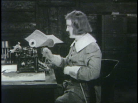 b/w 1923 man (snub pollard) with page-boy haircut hanging up telephone - 1923 stock videos & royalty-free footage