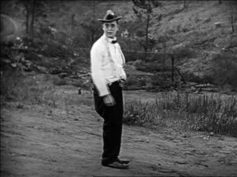 stockvideo's en b-roll-footage met b/w 1924 man with pincenez turning looking surprised / feature - 1924