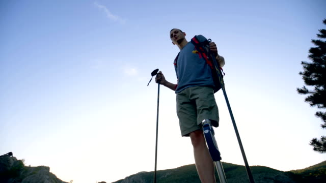 man with prosthetic leg climbing the mountain - amputee stock videos & royalty-free footage