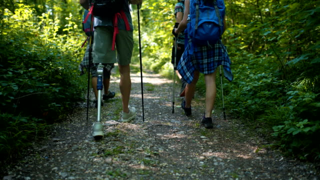 man with prosthetic leg hiking with friends - amputee stock videos and b-roll footage