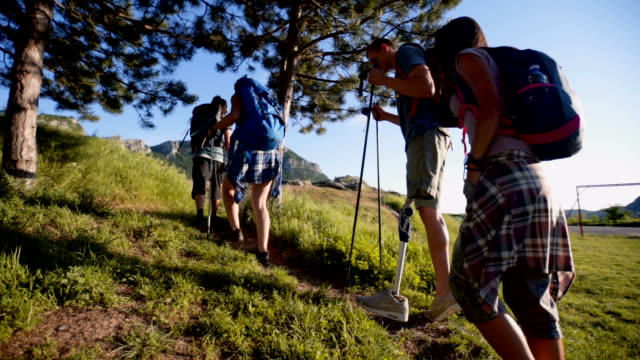 man with prosthetic leg hiking with friends - amputee stock videos & royalty-free footage