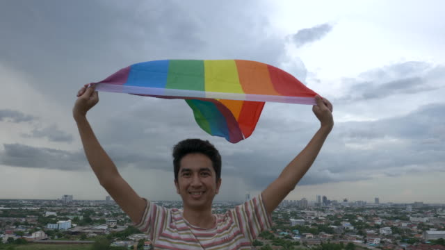 man with rainbow colour lgbt flag - spectrum stock videos & royalty-free footage