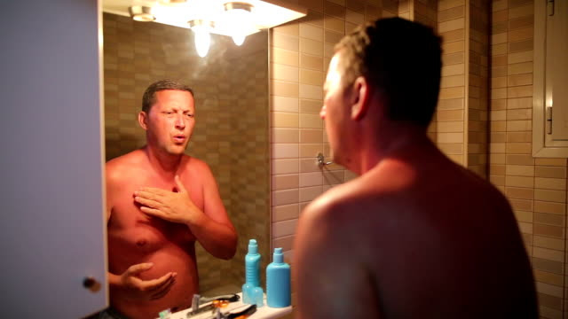 man with reddened, itchy skin after sunburn - peel stock videos & royalty-free footage