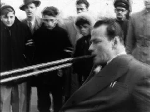 b/w 1949 man (charles bayerjon) with rope in mouth pulling bus (bus not visible) / quebec, canada / series - pulling stock videos & royalty-free footage
