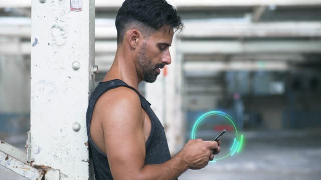 vídeos de stock e filmes b-roll de man with smart phone and motion graphics after exercise - abandoned