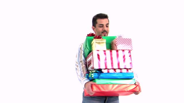 vídeos y material grabado en eventos de stock de man with stack of many gifts - un solo hombre de mediana edad