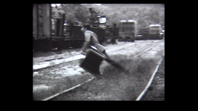 1968 man with suitcase trips on train track - comedian stock videos & royalty-free footage