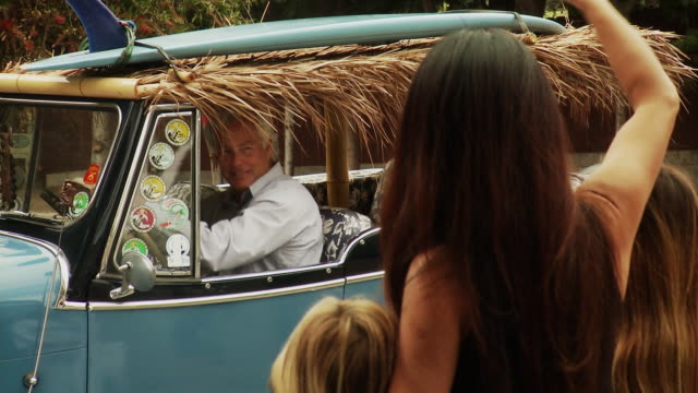 ms man with surfboard on roof of car driving off, waving good-bye to wife and children, laguna beach, california, usa - laguna beach california stock videos & royalty-free footage