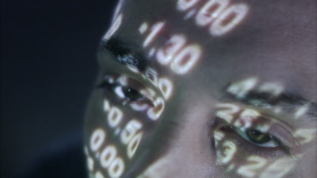 A man with the stock-exchange quotation reflected on his face.