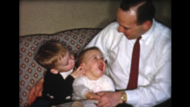1959 man with tie with two young children - two generation family stock videos & royalty-free footage