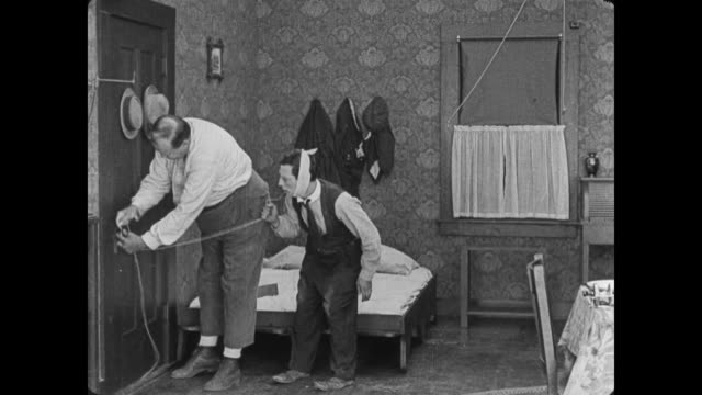 1920 Man (Buster Keaton) with toothache uses doorknob to yank out bad tooth