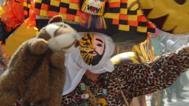 man with traditional costume during zoque coiteco carnival parade. mexican syncretism tradition at ocozocoautla de espinosa village, chiapas - kunst, kultur und unterhaltung stock-videos und b-roll-filmmaterial