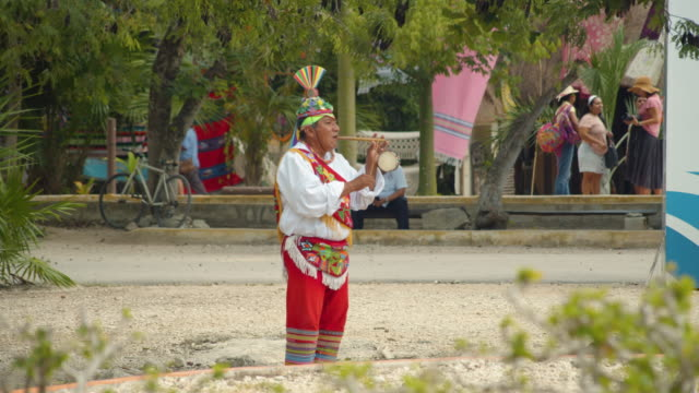 man with traditional costume playing music during danza de los voladores performance - stage costume stock videos & royalty-free footage