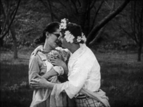 B/W 1926 man with wreath of flowers on head (Ben Turpin) kissing woman (Thelma Hill) with eyeglasses / feature