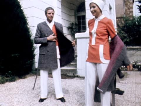 vídeos y material grabado en eventos de stock de a man woman and boy wear matching tunics and trousers designed by jacques esterel - ropa de caballero