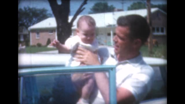 1959 man, woman and child near vintage car - two parents stock videos & royalty-free footage