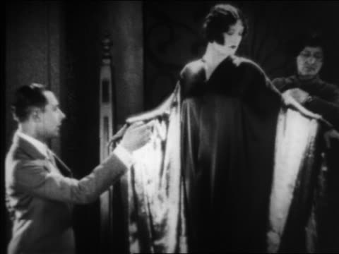 b/w 1925 man woman fitting lucille le sueur for gown / documentary - 1925 stock videos & royalty-free footage