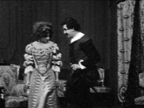 REENACTMENT B/W 1909 man wooing woman (Florence Laurence) in 17th century dress / she orders him out / feature
