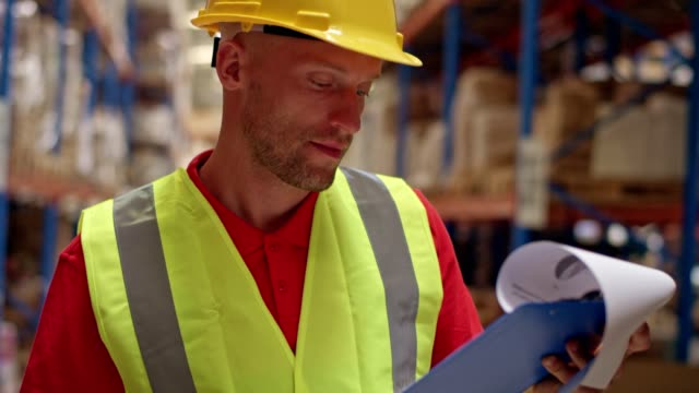 man working at a warehouse. counting stocks - satisfaction stock videos & royalty-free footage