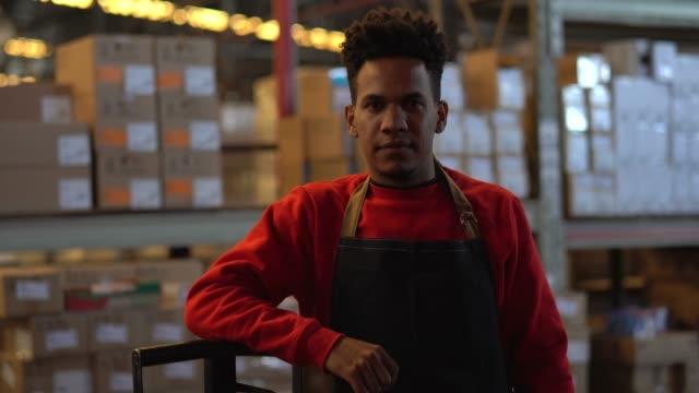 man working at a warehouse - pardo brazilian stock videos & royalty-free footage