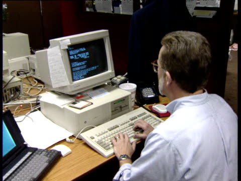man working at clinton gore campaign hq types on computer and sips drink little rock 1992 - bbc archive stock-videos und b-roll-filmmaterial