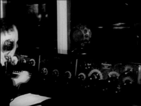 b/w 1927 rear view man working at control panel in radio station / newsreel - 1927 stock videos & royalty-free footage