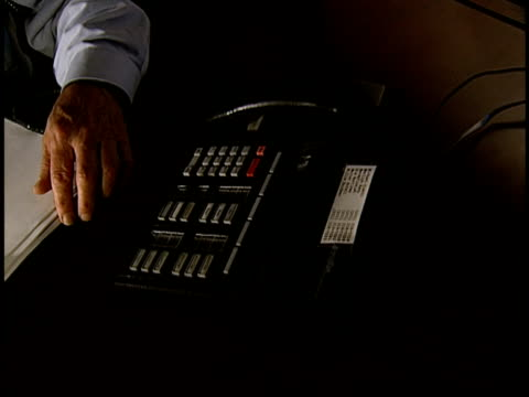 cu, pan, man working at desk, picking up landline phone, mid section - 1996 video stock e b–roll
