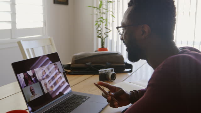 man working at home on a video conference - handsome people stock videos & royalty-free footage