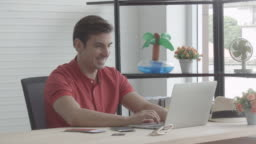 Man working at home with happiness