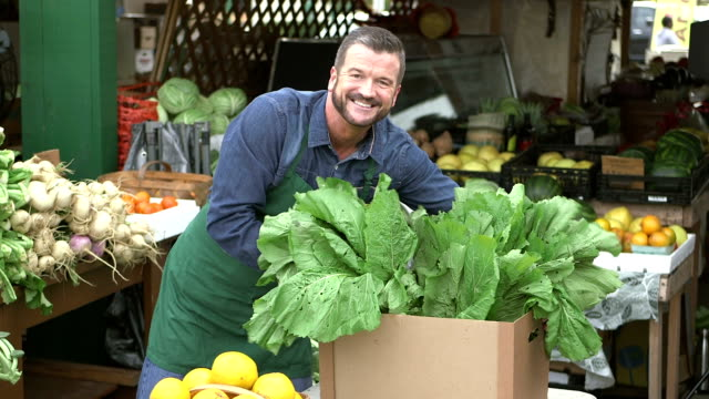 Man working at produce stand