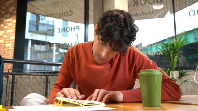 man working at table on open plan office - note pad stock videos & royalty-free footage