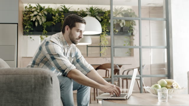 man working from home - loft apartment stock videos & royalty-free footage