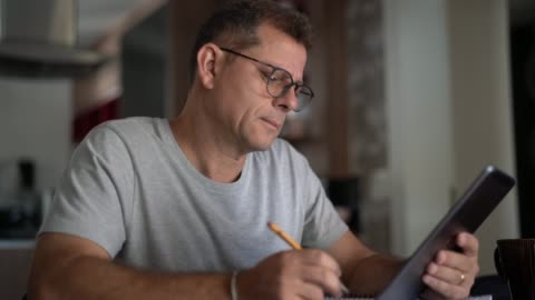 man working from home - one mature man only stock videos & royalty-free footage