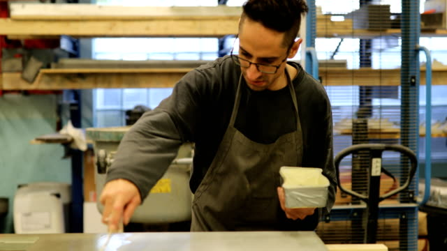 man working in a cement furniture making workshop - sigillante video stock e b–roll