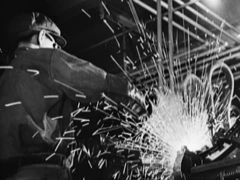 man working in a factory, welding - steel worker stock videos & royalty-free footage