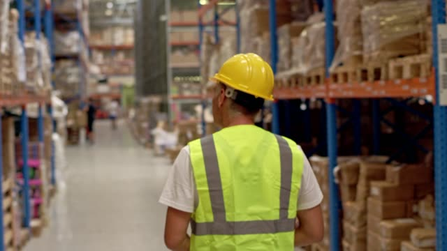 Man working in a warehouse. Checking stocks