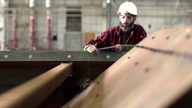 man working in factory inspecting equipment - owner stock videos and b-roll footage