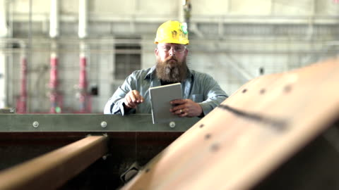 man working in factory inspecting equipment - beard stock videos & royalty-free footage