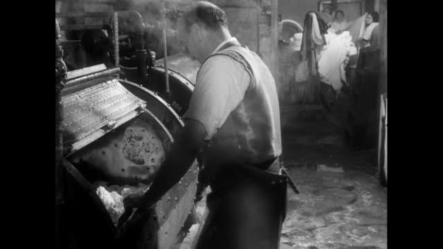 b&w man working in industrial laundry; 1963 - bedecken stock-videos und b-roll-filmmaterial