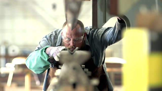 man working in metal fabrication shop - knowledge stock videos and b-roll footage