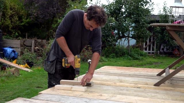 man working in workshop - sander stock videos & royalty-free footage