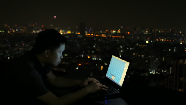 man working late on laptop - laptop remote location stock videos & royalty-free footage