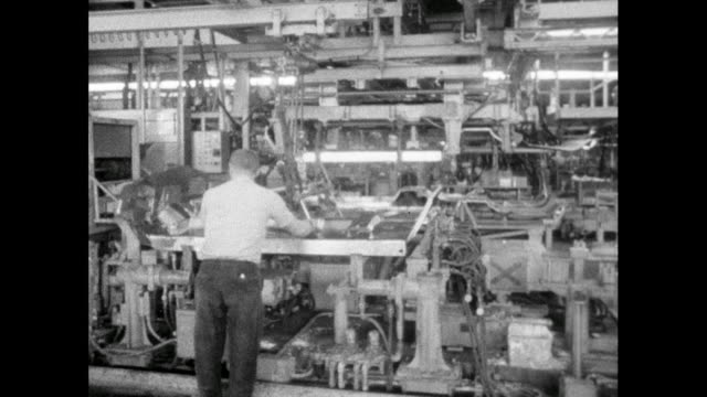 ws man working on car production line; 1965 - putting stock videos & royalty-free footage
